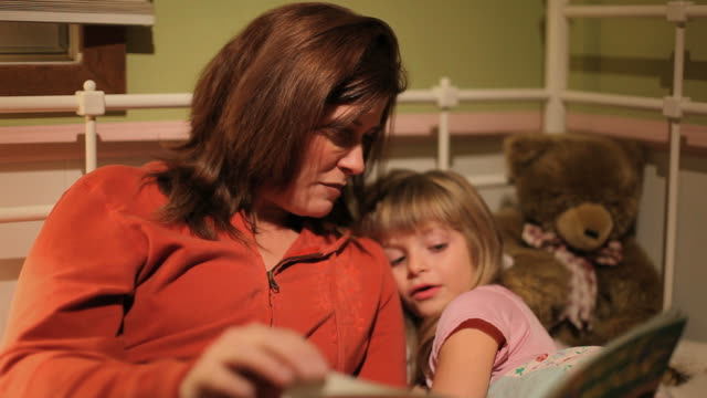 Mom Reading Bedtime Story to Child video