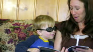 Mom reads to kid in goggles video
