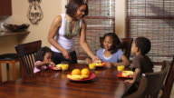 Mom serves lunch to children video