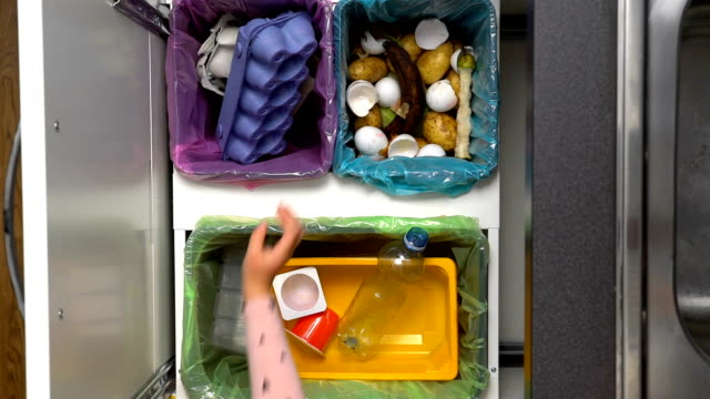 Mom Shows Your Child How To Sort Waste. Slow Motion video
