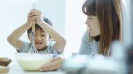 Mom Watching Son Make Pancake Mix video