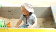 Mom with baby sandbox video