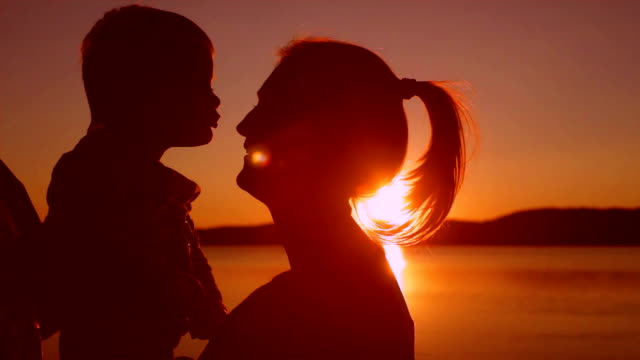 Mom with son during the sunset. video