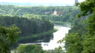 Monastery buildings and Neris river flowing between forest video