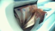 Money counter fed with 50 euro bills. video