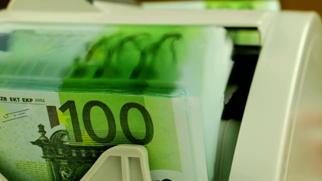 Money Counters and 100-Euro Banknotes video
