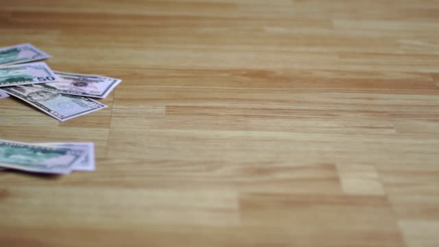 money fly across the floor from the wind video