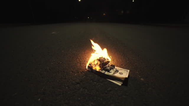 Money Stack Burning In The Street video