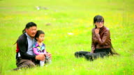 Mongolian family sitting on grass video