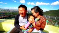 Mongolian family, Ulaanbaatar cityscape, Mongolia video