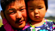 Mongolian man posing with his daughter video