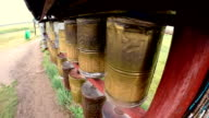Mongolian prayer wheels in Buddhism temple video