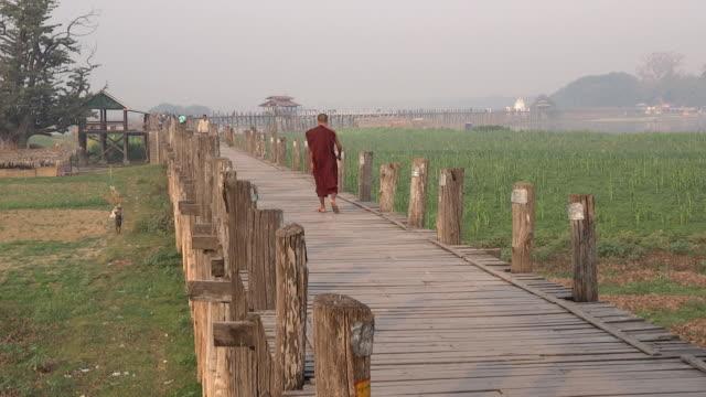 monk walking u bein bridge Mandalay Myanmar video
