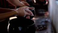 Monks wash their hands before eating. video