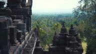 Montage - Borobudur temple with Buddha head video