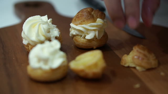 Montage - Hand making filling chuox cream puff and arranging for sell in bakery shop video