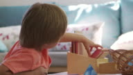 Montessori School Pupil Working At Desk With Wooden Shapes video