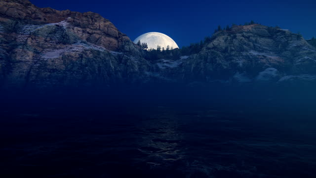 Moon over sea and mountains video