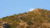 Moon set timelapse early morning, blue sky, day video