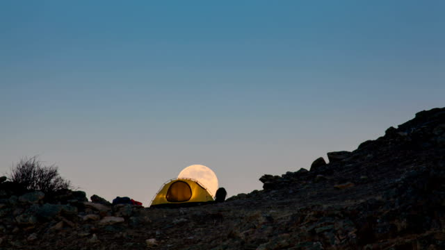 Moonrise above the tourist tent. Time-lapse. video