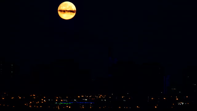 Moonset Over City Timelapse video