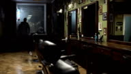 Morning. barber starts work day, preparing work place in his barber shop. FullHD video