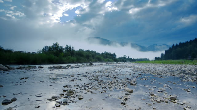 Morning fog in mountains and mountain river (Timelapse) video