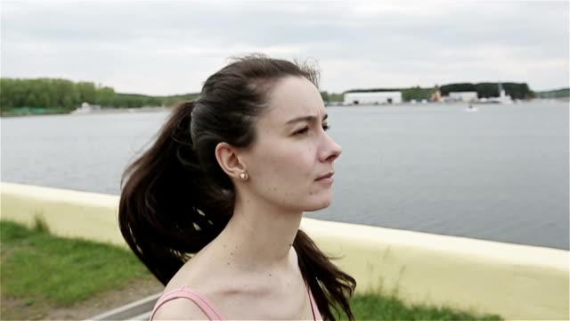 Morning jog of girl near the lake video