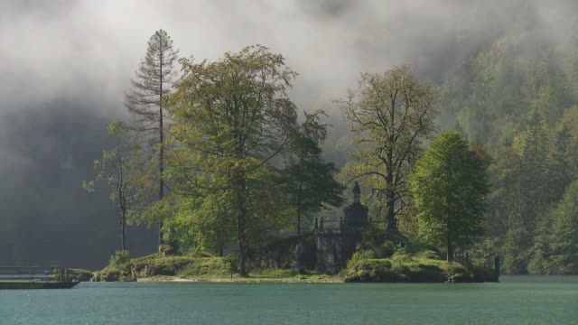 Morning Mist Clearing Over Little Island In Lake video