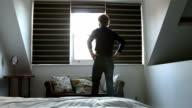 Morning, opening window blind.. video