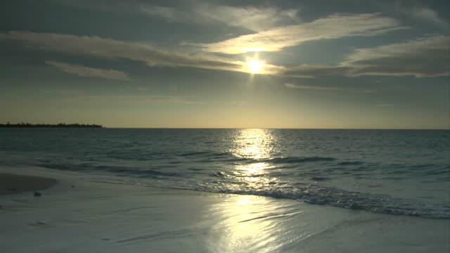 Morning sun over the ocean video