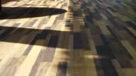 Morning sun shining on Beautiful wood texture vinyl floor, interior material video