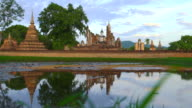 WS morning view of Sukhothai Historical Park at Mahathat temple reflecting in water video