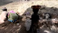 Moroccan women preparing a traditional tagine meal in oven video