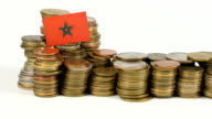 Morocco flag with stack of money coins video