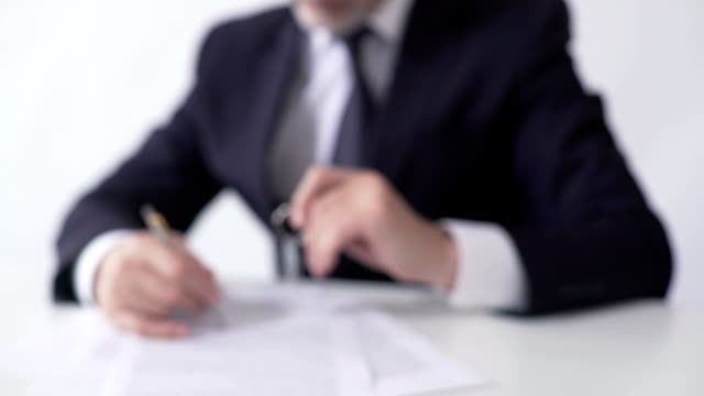 Mortgage broker signing papers, giving apartment keys to real estate buyer video