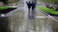 Moscow street with pedestrians walking under the rain video