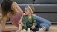 Mother and Baby Girl Playing with Toy Blocks video