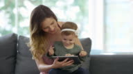 Mother and Baby Girl using a Digital Tablet video
