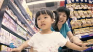 4K : Mother and Baby Shopping in supermarket video