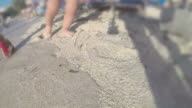 Mother and baby walking on beach sand, SLOW MOTION steadycam shoot video