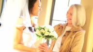 Mother and Bride Embracing Before Wedding Ceremony video