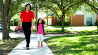 mother and child walking home from school slow motion video