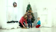 Mother and children decorate the Christmas tree video