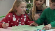Mother And Children Writing Letter To Santa Together video