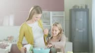 Mother and daughter baking cakes video