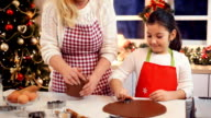 Mother and daughter baking cookies for Christmas video