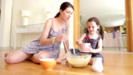 Mother And Daughter Baking Together video