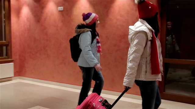 Mother and daughter come to the hotel,winter vacation video