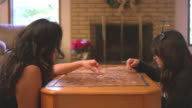 Mother and daughter doing a puzzle together in the living room video